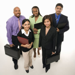 Portrait of multi-ethnic business group standing and holding a briefcases